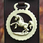 Display strap with 7 horse brasses